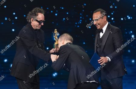 Tim Burton (L) with Italian film director Alessio Cremonini (C) and Italian presenter Carlo Conti (R) on stage in the occasion of the 64th edition of the David di Donatello Awards in Rome, Italy, 27 March 2019. The David di Donatello award is a film prize presented annually to honor the best of Italian and foreign motion picture productions.