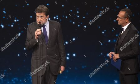 Nanni Moretti with presenter Carlo Conti (R) on stage in the occasion of the 64th edition of the David di Donatello Awards in Rome, Italy, 27 March 2019. The David di Donatello award is a film prize presented annually to honor the best of Italian and foreign motion picture productions.