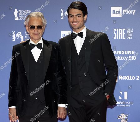 Italian tenor Andrea Bocelli (L) with his son Matteo pose for a photo on the red carpet in the occasion of the 64th edition of the David di Donatello Awards in Rome, Italy, 27 March 2019. The David di Donatello award is a film prize presented annually to honor the best of Italian and foreign motion picture productions.