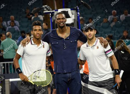 Feliz Auger-Aliassime (CAN), from left, Chris Bosh, and Borna Coric (CRO) pose for a picture.