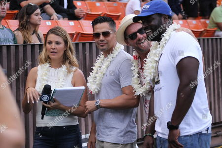 Amanda Balionis talks with the new Magnum P.I. actor Jay Hernandez and co-stars Zachary Knighton (Rick) and Stephen Hill (T.C.) during a game between the Hawaii Rainbow Warriors and the Navy Midshipmen at Aloha Stadium in Honolulu, HI - Michael Sullivan/CSM