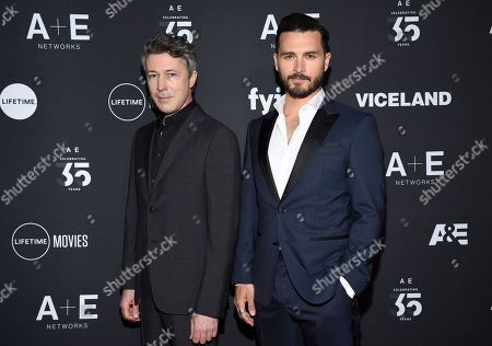 """Aidan Gillen, Michael Malarkey. Project Blue Book"""" cast members Aidan Gillen, left, and Michael Malarkey attend A+E Networks' 2019 Upfront at Jazz at Lincoln Center, in New York"""