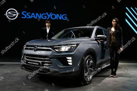 Models pose next a Ssangyong Motor Korando during the 2019 Seoul Motor Show at the Korea