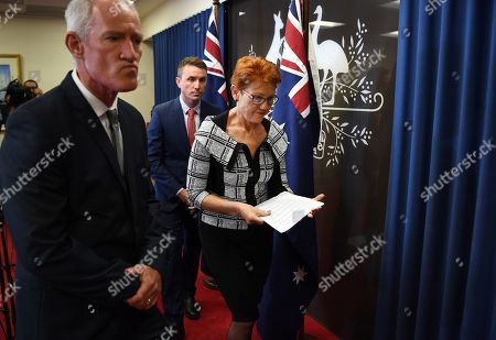 Queensland Senator and Australian One Nation party leader Pauline Hanson (R), flanked by party officials James Ashby (2-R) and Steve Dickson (L), leaves after a press conference in Brisbane, Australia, 28 March 2019. Party officials James Ashby and Steve Dickson were caught in an al-Jazeera investigation which used hidden cameras and a journalist posing as a gun campaigner to expose the far-right party's extraordinary efforts to obtain funding in Washington DC in September 2018.