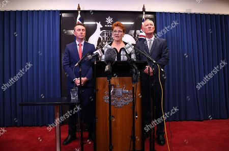 Queensland Senator and Australian One Nation party leader Pauline Hanson (C), flanked by party officials James Ashby (L) and Steve Dickson (R), speaks during a press conference in Brisbane, Australia, 28 March 2019. Party officials James Ashby and Steve Dickson were caught in an al-Jazeera investigation which used hidden cameras and a journalist posing as a gun campaigner to expose the far-right party's extraordinary efforts to obtain funding in Washington DC in September 2018.