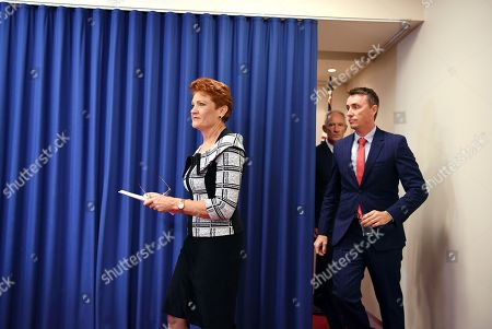 Queensland Senator and Australian One Nation party leader Pauline Hanson (L) arrives with party officials James Ashby (R) and Steve Dickson (2-R), at a press conference in Brisbane, Australia, 28 March 2019. Party officials James Ashby and Steve Dickson were caught in an al-Jazeera investigation which used hidden cameras and a journalist posing as a gun campaigner to expose the far-right party's extraordinary efforts to obtain funding in Washington DC in September 2018.