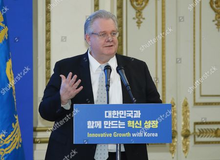 Stock Picture of Jeffrey Jones, chairman of the Board of Governors of the American Chamber of Commerce in Korea, speaks as he takes part in a meeting between President Moon Jae-in and business leaders of foreign companies operating in South Korea, at the presidential office Cheong Wa Dae in Seoul, South Korea, 28 March 2019.