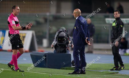 Referee Rosario Abisso speaks to Chievo Verona's coach Domenico Di Carlo.