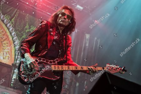 Stock Picture of London United Kingdom - November 16: American Rock Bassist Dennis Dunaway Performing Live On Stage As Part Of Alice Cooper's Band At Wembley Arena In London On November 16
