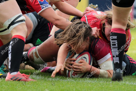 Leanne Riley of Harlequins is just short of the try line