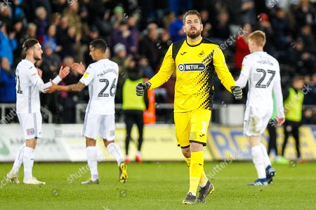 Kristoffer Nordfeldt of Swansea City celebrates his role in their second goal