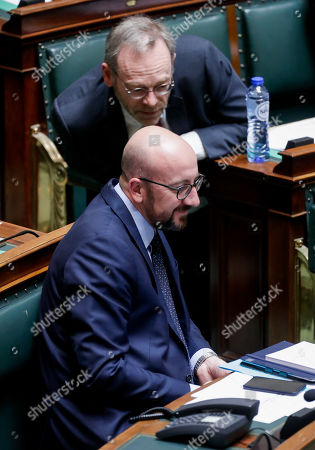 Belgian Prime Minister Charles Michel (top) and New Flemish Alliance (N-VA) head of group Peter De Roover (bottom) attend a plenary session at the federal parliament in Brussels, Belgium, 28 March 2019. The main subject of the plenary session is a discussion on the Climat act.