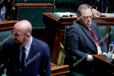 Belgian Prime Minister Charles Michel (L) and New Flemish Alliance (N-VA) head of group Peter De Roover (R) attend a plenary session at the federal parliament in Brussels, Belgium, 28 March 2019. The main subject of the plenary session is a discussion on the Climat act.