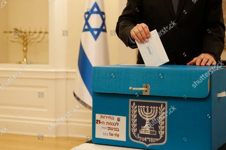 Mark Regev, the Israeli Ambassador to Britain holds his voting ballot in his hands as he votes at the Israeli Embassy in London, . Some 5000, Israeli citizens worldwide who work for the government or official industries are allowed to vote abroad, other citizens must vote by being in Israel. The election day in Israel is April 9, but embassies abroad vote up to two weeks early to allow the votes to be sent to, and counted in Israel