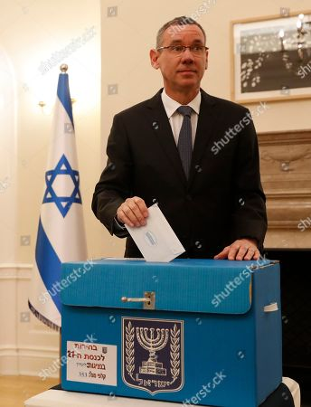 Stock Picture of Mark Regev, the Israeli Ambassador to Britain holds his voting ballot to vote at the Israeli Embassy in London, . Some 5000, Israeli citizens worldwide who work for the government or official industries are allowed to vote abroad, other citizens must vote by being in Israel. The election day in Israel is April 9, but embassies abroad vote up to two weeks early to allow the votes to be sent to, and counted in Israel