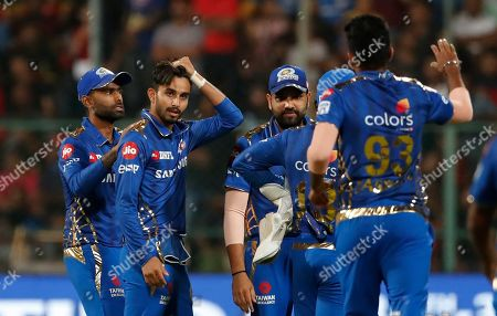 Mumbai Indians' Mayank Markande, second left, celebrates with teammates the dismissal of Royal Challengers Bangalore's Parthiv Patel during the VIVO IPL T20 cricket match between Royal Challengers Bangalore and Mumbai Indians in Bangalore, India
