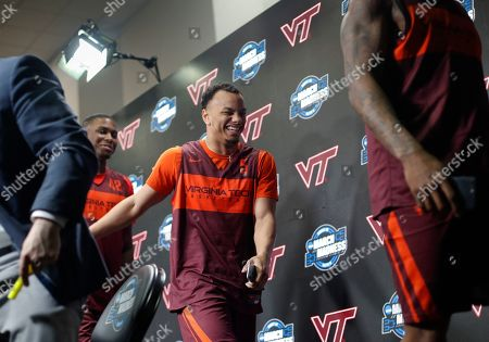 Ty Outlaw, Justin Robinson, Ahmed Hill. Virginia Tech guard Justin Robinson, center, smiles as he walks off stage with teammates Ty Outlaw, left, and Ahmed Hill, right, at the conclusion of a news conference at the NCAA men's college basketball tournament in Washington, . Virginia Tech plays Duke in an East Regional semifinal game on Friday