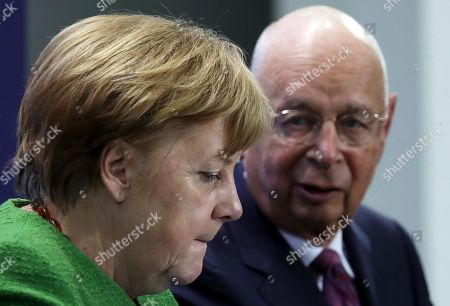 German Chancellor Angela Merkel (L) listens to the founder and Executive Chairman of the World Economic Forum Klaus Schwab (R) at the beginning of their meeting in Berlin, Germany, 28 March 2019. Merkel met a business delegation at the Chancellery.