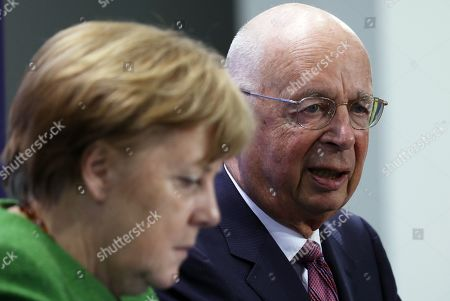 German Chancellor Angela Merkel (L) speaks next to the founder and Executive Chairman of the World Economic Forum Klaus Schwab (R) at the beginning of their meeting in Berlin, Germany, 28 March 2019. Merkel met a business delegation at the Chancellery.
