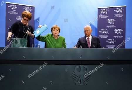 German Chancellor Angela Merkel (C) speaks next to the founder and Executive Chairman of the World Economic Forum Klaus Schwab (R) at the beginning of their meeting in Berlin, Germany, 28 March 2019. Merkel met a business delegation at the Chancellery.