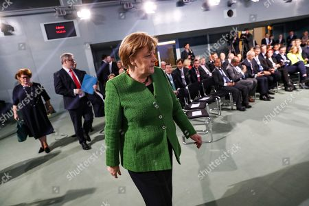 German Chancellor Angela Merkel (C) attends a meeting with the founder and Executive Chairman of the World Economic Forum Klaus Schwab in Berlin, Germany, 28 March 2019. Merkel met a business delegation at the Chancellery.
