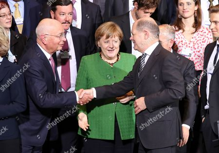 The founder and Executive Chairman of the World Economic Forum Klaus Schwab (L) shakes hands with German Minister of Finance Olaf Scholz (R) next to German Chancellor Angela Merkel (C) after a meeting in Berlin, Germany, 28 March 2019. Merkel met a business delegation in the Chancellery.
