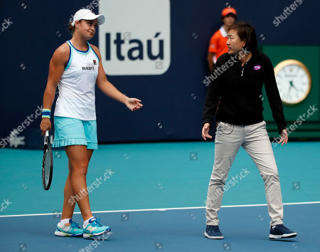 Stock Image of Chair umpire Jennifer Zhang (R) talks to Ashleigh Barty of Australia (L) on the court during a rain stoppage at the Miami Open tennis tournament in Miami, Florida, USA, 28 March 2019.
