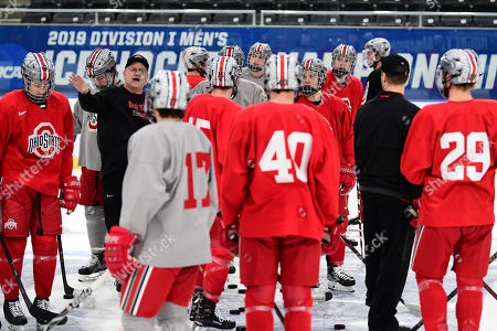 Ohio State University assistant coach Steve Miller addresses the players during practice on media day leading up to the NCAA Men's Hockey West Regional at Scheels Arena, Fargo, ND. They play Denver on Friday in the semi-final