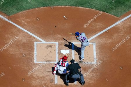 New York Mets second baseman Robinson Cano (R) hits a solo home run off Washington Nationals starting pitcher Max Scherzer as Washington Nationals catcher Yan Gomes (L) and umpire Bill Miller (C) look on in the first inning of the MLB baseball game between the Washington Nationals and the New York Mets at Nationals Park in Washington, DC, USA, 28 March 2019.