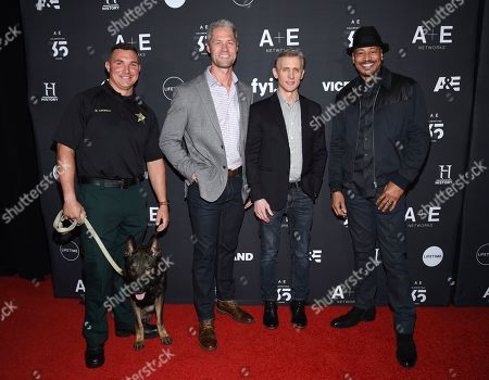 "Nick Carmack, Sean Larkin, Dan Abrams, Tom Morris Jr. Live PD"" cast members, from left, Deputy Nick Carmack and K9 Shep, Sgt. Sean 'Sticks' Larkin, Dan Abrams and Tom Morris Jr. attend A+E Networks' 2019 Upfront at Jazz at Lincoln Center, in New York"