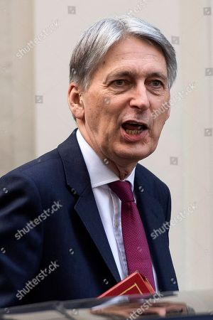 Stock Photo of Chancellor of the Exchequer Philip Hammond leaves Downing Street, in London, Britain, 28 March 2019. The British MPs are to debate and vote on the withdrawal agreement only on 29 March 2019.