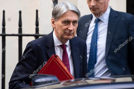 Chancellor of the Exchequer Philip Hammond leaves Downing Street, in London, Britain, 28 March 2019. The British MPs are to debate and vote on the withdrawal agreement only on 29 March 2019.
