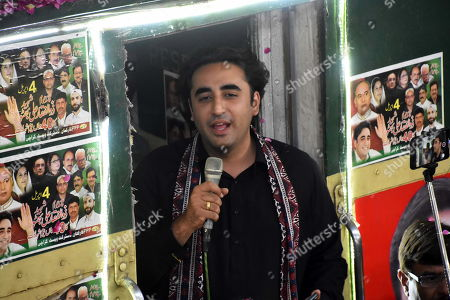 Bilawal Bhutto Zardari (C) chairman of opposition party Pakistan People Party talks with supporters onboard a train, as he reached Larkana, Pakistan, 28 April 2019. Titled as 'Caravan-e-Bhutto', the special train of the Pakistan Railways will reach its final stop in Larkana on 27 March.