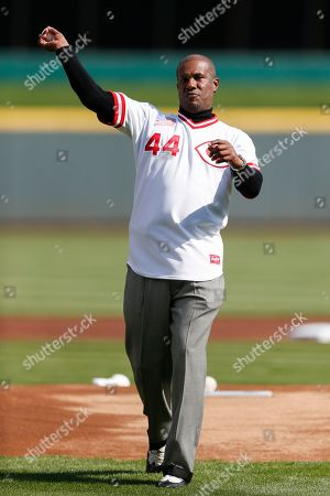 Former Cincinnati Reds player Eric Davis throws out the ceremonial first pitch before an opening day baseball game against the Pittsburgh Pirates, in Cincinnati