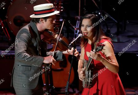 "Stock Photo of Ketch Secor, Rhiannon Giddens. Ketch Secor, left, and Rhiannon Giddens perform during a television taping for the new Ken Burns documentary ""Country Music"" at the Ryman Auditorium, in Nashville, Tenn. The PBS film is set to air in September"