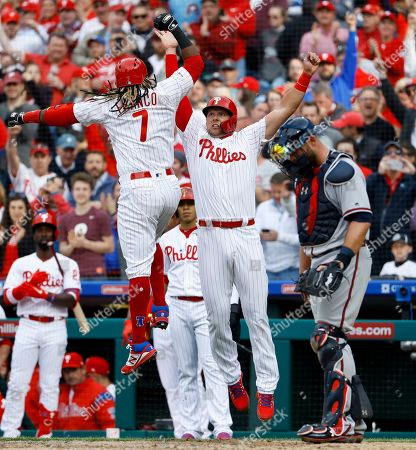 Stock Image of Rhys Hoskins, Brian McCann, Maikel Franco. Philadelphia Phillies' Maikel Franco, left, celebrates with Rhys Hoskins, center, next to Atlanta Braves catcher Brian McCann after Franco's three-run home run off Atlanta Braves relief pitcher Shane Carle during the sixth inning of an opening-day baseball game, in Philadelphia. Philadelphia won 10-4