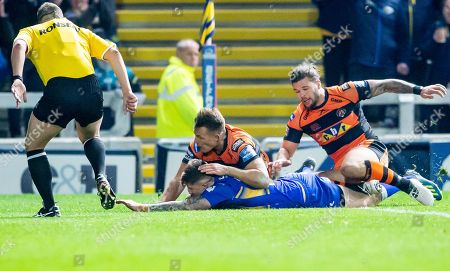 Castleford's Greg Eden & Alex Foster can't prevent Leeds' Liam Sutcliffe from scoring a try.