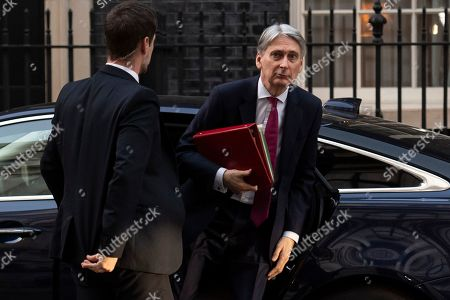 Stock Image of Chancellor of the Exchequer Philip Hammond arrives in Downing Street, in London, Britain, 28 March 2019. The British MPs are to debate and vote on the withdrawal agreement only on 29 March 2019.