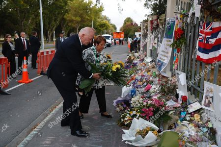 Australian Governor-General Sir Peter Cosgrove (L) and his wife Lynne (R), Lady Cosgrove pay tribute outside the Al-Noor Mosque in Christchurch, New Zealand, 29 March 2019. A gunman killed 50 worshippers at the Al Noor Masjid and Linwood Masjid in Christchurch, New Zealand on 15 March.
