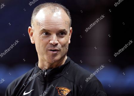 Oregon State head coach Scott Rueck talks to a member of his staff during practice at the NCAA women's college basketball tournament, in Albany, N.Y. Oregon State faces Louisville in a regional semifinal game on Friday