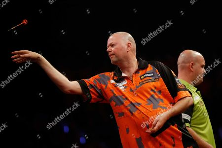 Dutch Raymond van Barneveld in action against Dutch Michael van Gerwen (R) during the Premier League Darts in Rotterdam, Thursday 28 March 2019. 'Barney' lost his very last Premier League match with 7-1.