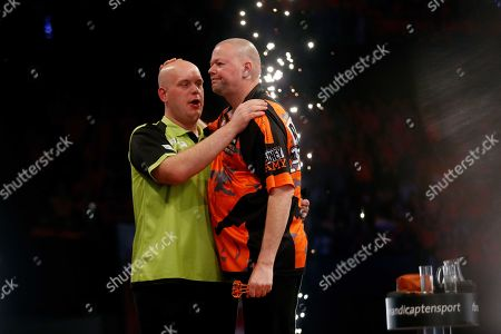 Stock Image of Dutch Michael van Gerwen (L) hugs Raymond van Barneveld after their match during the Premier League Darts in Rotterdam, Thursday 28 March 2019. 'Barney' lost his very last Premier League match with 7-1.
