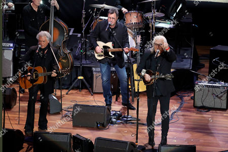 """Marty Stuart, left; Vince Gill, center; and Ricky Skaggs perform during a television taping for the new Ken Burns documentary """"Country Music"""" at the Ryman Auditorium, in Nashville, Tenn. The PBS film is set to air in September"""