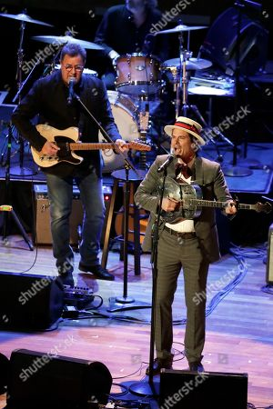 """Ketch Secor, right, and Vince Gill perform during a television taping for the new Ken Burns documentary """"Country Music"""" at the Ryman Auditorium, in Nashville, Tenn. The PBS film is set to air in September"""