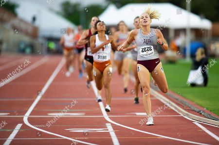 Stock Image of Hannah Campbell #3232 with Texas A&M in action Women 1500 Meter Run Section B Univ at The Clyde Littlefield Texas Relays, Mike A. Myers Stadium. Austin, Texas
