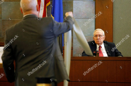Former U.S. Sen. Harry Reid sits in the witness stand, in Las Vegas. Reid testified in his negligence lawsuit against the maker of an exercise device