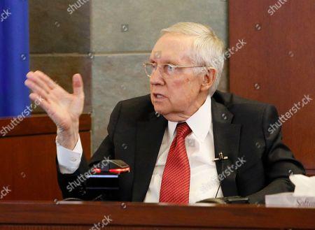 Former U.S. Sen. Harry Reid speaks from the witness stand, in Las Vegas. Reid testified in his negligence lawsuit against the maker of an exercise device