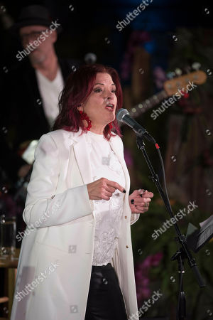 """Grammy Award winner Rosanne Cash performs at the opening of """"Votes for Women: A Portrait of Persistence"""" at the Smithsonian's National Portrait Gallery on in Washington"""