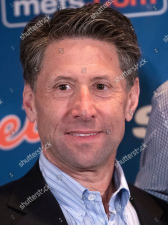 New York Mets COO Jeff Wilpon appears with Mets starting pitcher Jacob deGrom (48) at a press conference on his new five-year contract extension at the Ritz-Carlton Hotel in Arlington, Virginia.