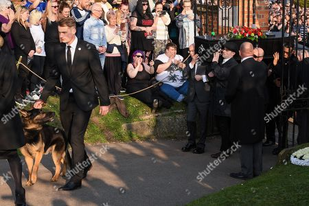 The coffin of Keith Flint with dog Cyrus